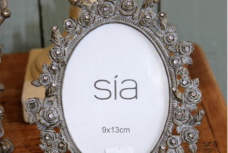 Photograph frame, oval, grey with flower effect.